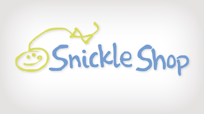 Logo design for the Snickle Shop with a handwritten, blue font. There is a hand drawing of a child smiling with a long line and a bow trailing away in green.