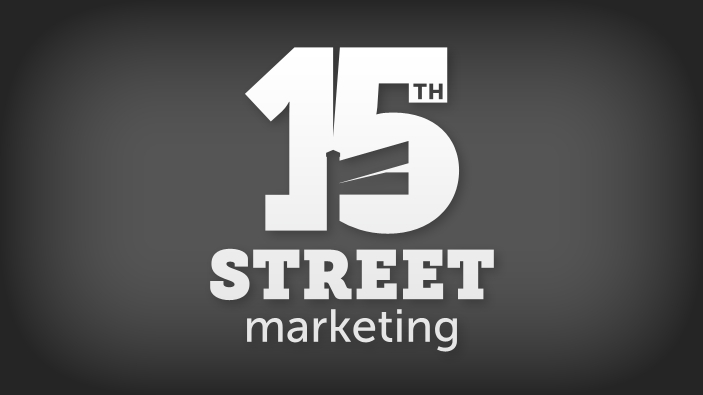 Bold numeral 15 with corner street sign in negative space between the numerals 1 and 5, white logo on dark grey background.